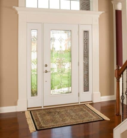 white entry door with transom and side lites