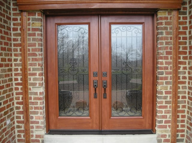 french doors with large glass segments in brick