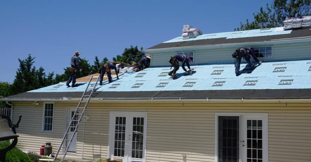 People Working on Roof