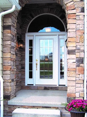 stone entrance with circle top door