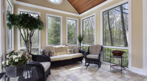 Multiple windows surrounding seating area in house