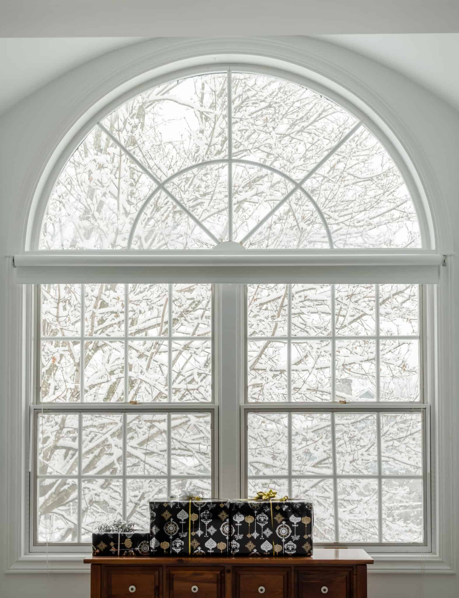 Large white transom window with snowy background