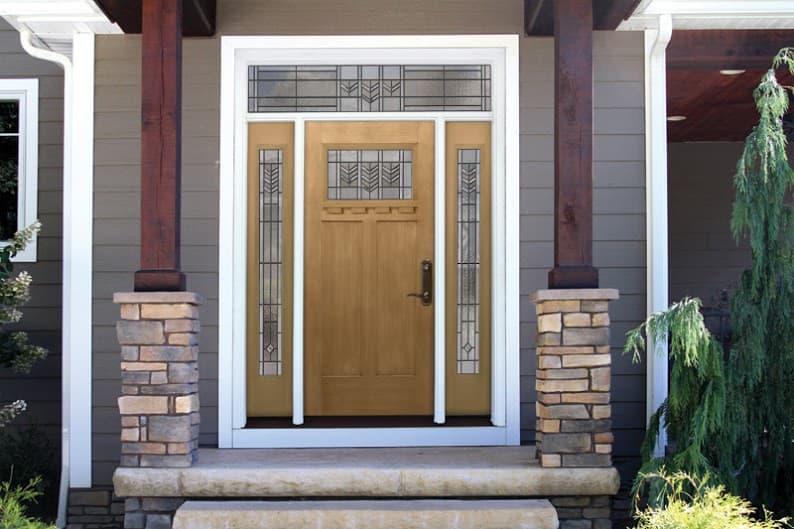 Modern transom window design above entry wood door