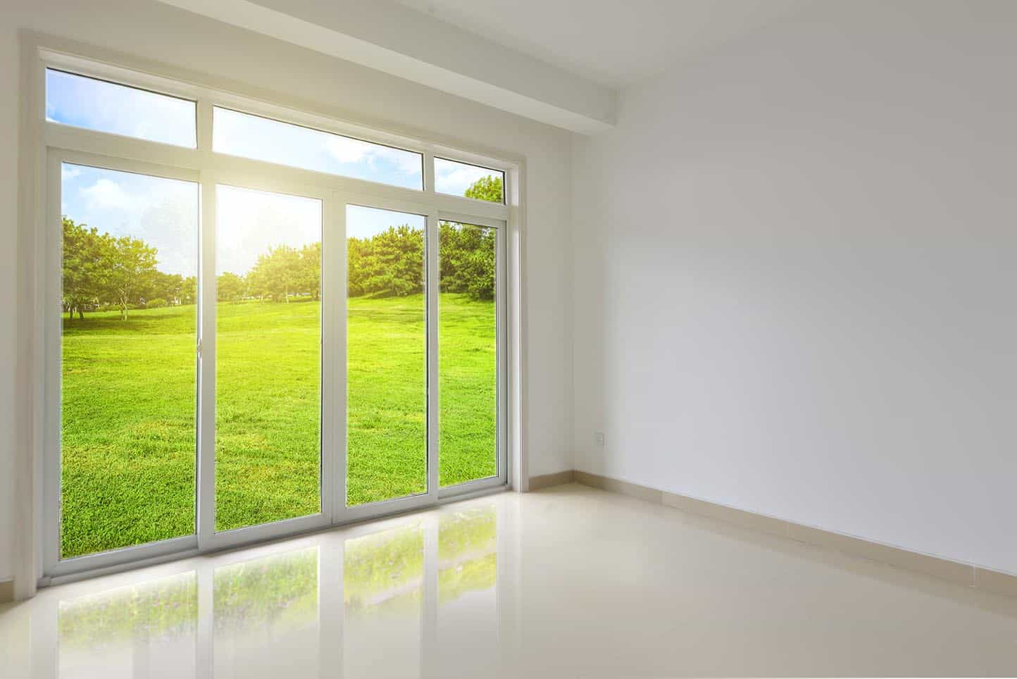 Transom windows growing above sliding doors