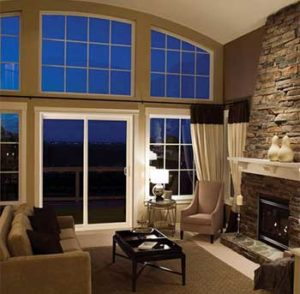 Interior view of white sliding glass patio doors with large transom