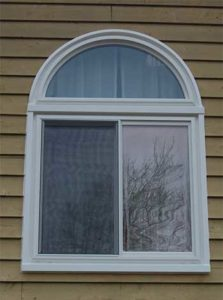 Sliding white window with arched transom