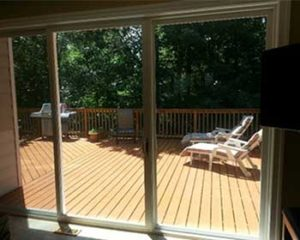 Triple sliding glass door with view of outside deck