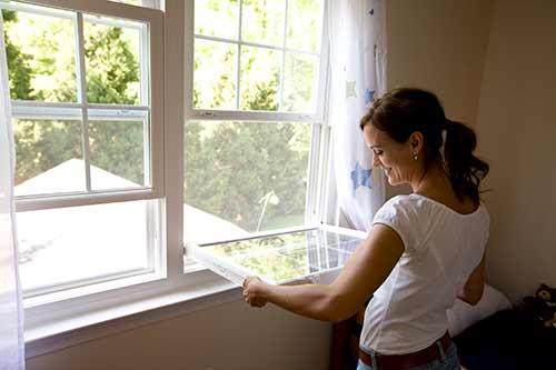 person with open vinyl window