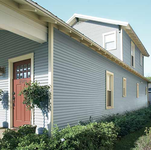 Light blue vinyl siding on two story home