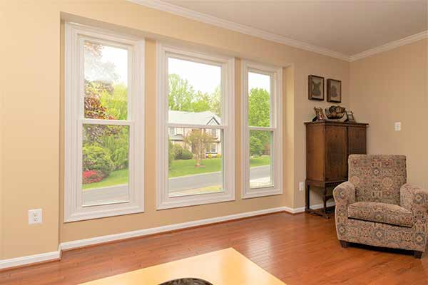 Three white Thompson Creek windows in living room