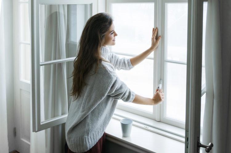 woman closing energy efficient window
