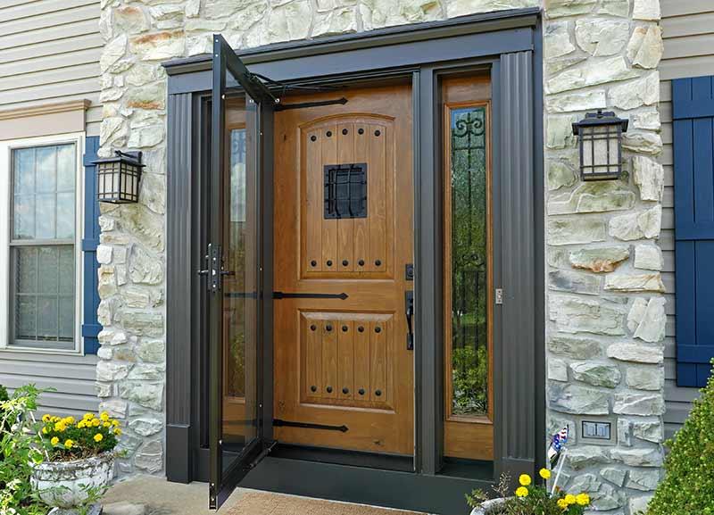 Custom front door with dark brown vinyl energy efficient glass